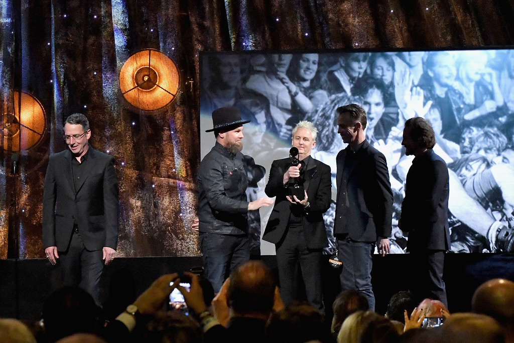. NEW YORK, NY - APRIL 07:  2017 Inductees Eddie Vedder, Stone Gossard, Jeff Ament, Mike McCready and Matt Cameron of Pearl Jam speak onstage at the 32nd Annual Rock & Roll Hall Of Fame Induction Ceremony at Barclays Center on April 7, 2017 in New York City. The event will broadcast on HBO Saturday, April 29, 2017 at 8:00 pm ET/PT  (Photo by Mike Coppola/Getty Images)