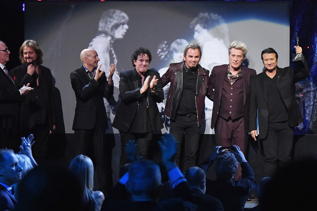 . NEW YORK, NY - APRIL 07:  2017 Inductees Aynsley Dunbar, Gregg Rolie, Steve Smith, Steve Perry, Neal Schon and Jonathan Cain of Journey accept an award onstage at the 32nd Annual Rock & Roll Hall Of Fame Induction Ceremony at Barclays Center on April 7, 2017 in New York City. The event will broadcast on HBO Saturday, April 29, 2017 at 8:00 pm ET/PT  (Photo by Mike Coppola/Getty Images)