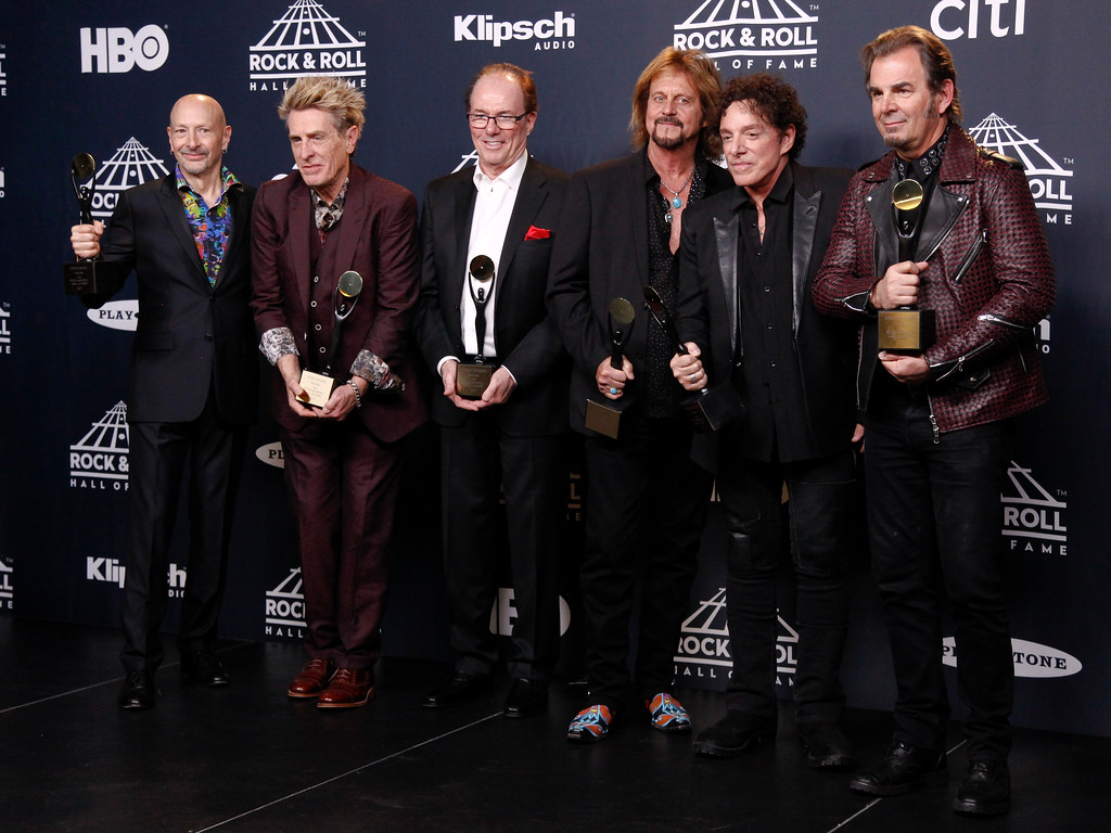. Steve Smith, from left, Ross Valory, Aynsley Dunbar, Gregg Rolie, Neal Schon and Jonathan Cain of the band Journey pose in the 2017 Rock and Roll Hall of Fame induction ceremony press room at the Barclays Center on Friday, April 7, 2017, in New York. (Photo by Andy Kropa/Invision/AP)