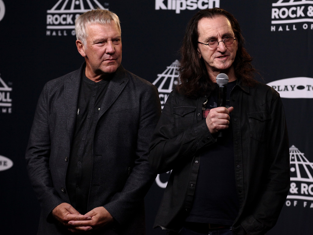 . Alex Lifeson, left, and Geddy Lee, right, of the band Rush pose in the 2017 Rock and Roll Hall of Fame induction ceremony press room at the Barclays Center on Friday, April 7, 2017, in New York. (Photo by Andy Kropa/Invision/AP)