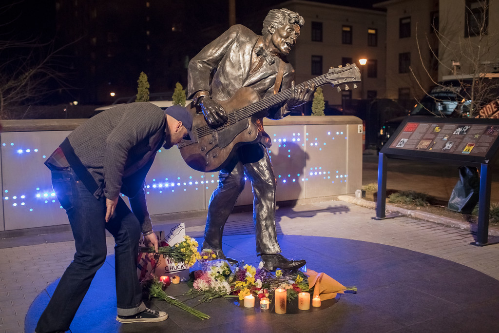. UNIVERSITY CITY, MO - MARCH 18:  A man places flowers below a statue of singer and musician Chuck Berry in University City, Missouri, on March 18, 2017. The rock \'n\' roll pioneer died today at the age of 90 at his home in a suburb of St. Louis, Missouri. (Photo by Whitney Curtis/Getty Images)