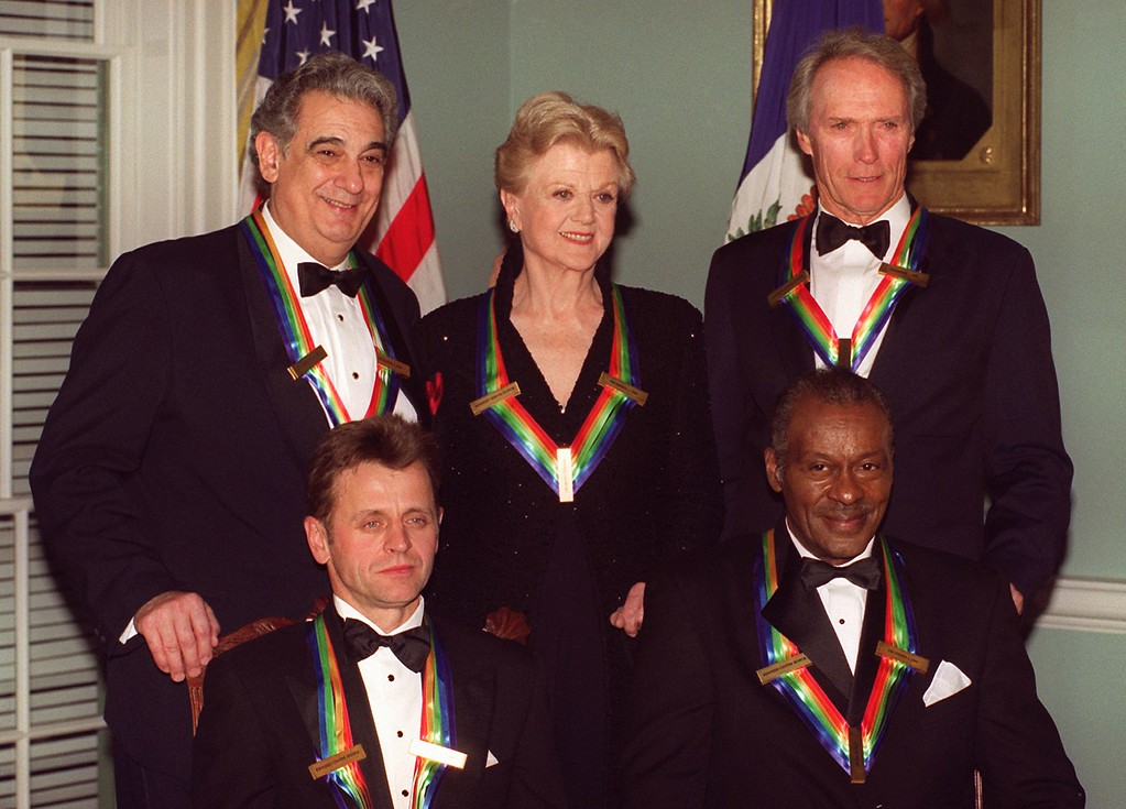 . WASHINGTON, DC - DECEMBER 2:  Kennedy Center Honorees (clockwise), actress Angela Lansbury, actor-director Clint Eastwood, rock-and-roll pioneer Chuck Berry, dancer Mikhail Baryshnikov and tenor Placido Domingo, pose for the photographer during the Kennedy Center Honors Gala, hosted by US Secretary of State Madeleine Albright, at the State Department in Washington, DC, 02 December 2000. The Kennedy Center selected five artists who have electrified American pop-culture as this year\'s Kennedy Center Honorees.  (NESHAN H. NALTCHAYAN/AFP/Getty Images)