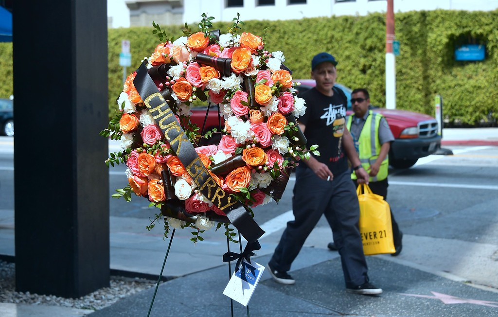 . A man walks by a wreath, courtesy of the Hollywood Chamber of Commerce, for the late Chuck Berry\'s Hollywood Walk of Fame star on March 20, 2017 in Hollywood, California. The singer, songwriter and pioneer of rock and roll music, died of natural causes on March 18, 2017.  (FREDERIC J. BROWN/AFP/Getty Images)