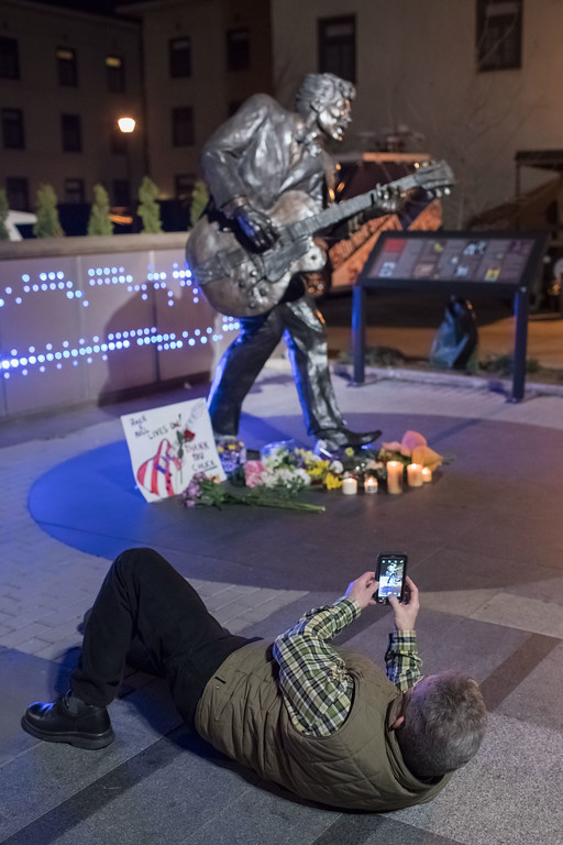 . UNIVERSITY CITY, MO - MARCH 18: A man takes a photos of a statue of singer and musician Chuck Berry in University City, Missouri, on March 18, 2017. The rock \'n\' roll pioneer died today at the age of 90 at his home in a suburb of St. Louis, Missouri. (Photo by Whitney Curtis/Getty Images)