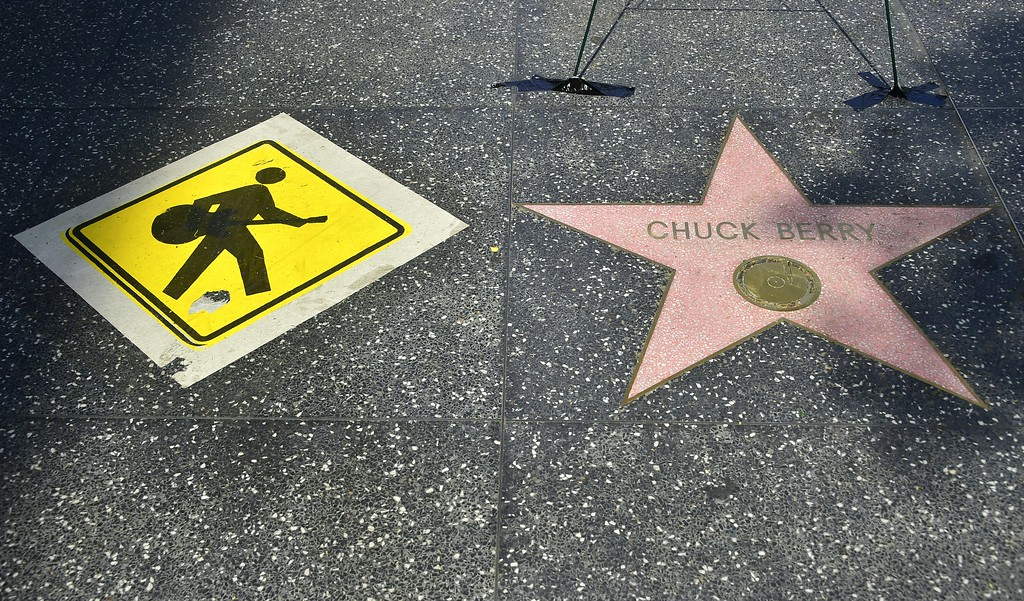 . Momentos are placed next to the star for the late Chuck Berry on the Hollywood Walk of Fame  on March 20, 2017 in Hollywood, California. The singer, songwriter and pioneer of rock and roll music, died of natural causes on March 18, 2017.  (FREDERIC J. BROWN/AFP/Getty Images)