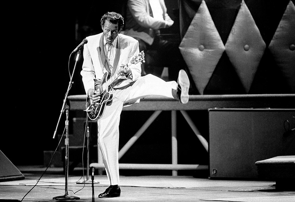 ". FILE - In this Oct. 17, 1986 file photo, Chuck Berry performs during a concert celebration for his 60th birthday at the Fox Theatre in St. Louis, Mo. Berry, rock \'n\' roll\'s founding guitar hero and storyteller who defined the music\'s joy and rebellion in such classics as ""Johnny B. Goode,\"" \'\'Sweet Little Sixteen\"" and \""Roll Over Beethoven,\"" died Saturday, March 18, 2017, at his home west of St. Louis. He was 90. (AP Photo/James A. Finley)"