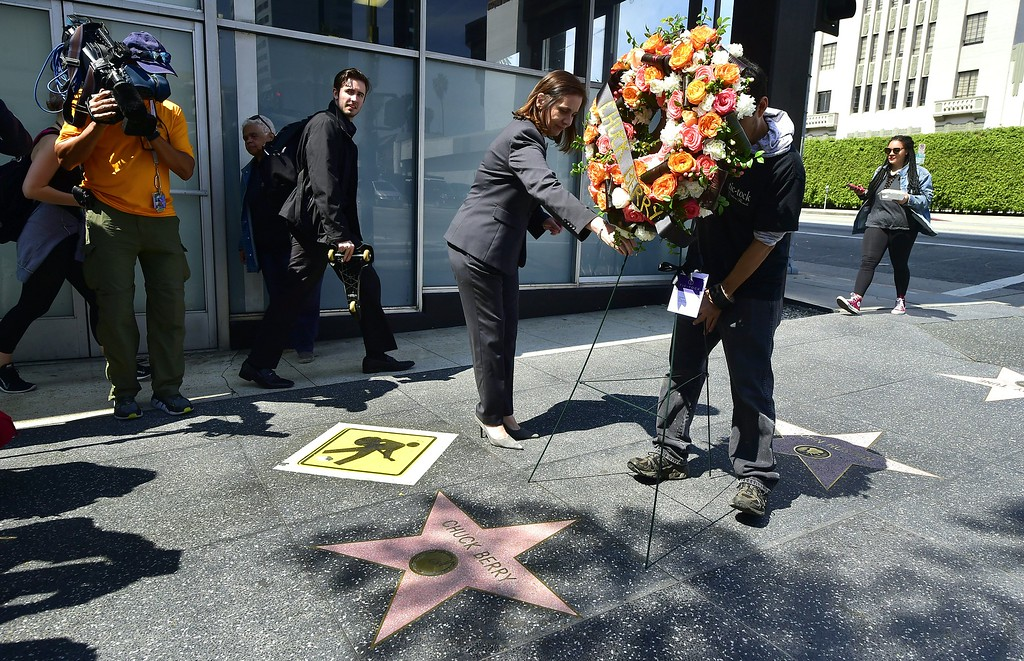 . A wreath, courtesy of the Hollywood Chamber of Commerce, arrives on delivery to the late Chuck Berry\'s Hollywood Walk of Fame star on March 20, 2017 in Hollywood, California. The singer, songwriter and pioneer of rock and roll music, died of natural causes on March 18, 2017.  (FREDERIC J. BROWN/AFP/Getty Images)