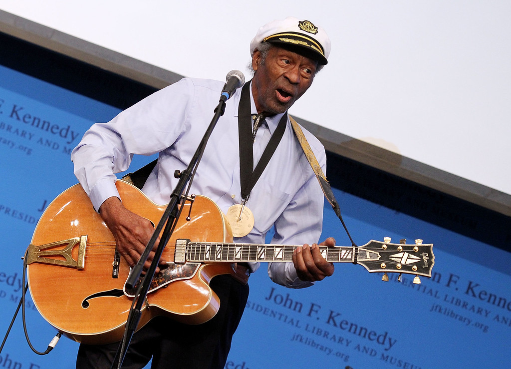 """. Chuck Berry performs during the 2012 Awards for Lyrics of Literary Excellence at The John F. Kennedy Presidential Library And Museum on February 26, 2012 in Boston, Massachusetts. Berry, rock \'n\' roll\'s founding guitar hero and storyteller who defined the music\'s joy and rebellion in such classics as \""""Johnny B. Goode,\"""" \'\'Sweet Little Sixteen\"""" and \""""Roll Over Beethoven,\"""" died Saturday, March 18, 2017, at his home west of St. Louis. He was 90. (Photo by Marc Andrew Deley/Getty Images)"""