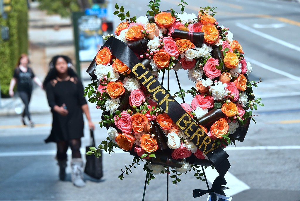 . A woman walks by a wreath, courtesy of the Hollywood Chamber of Commerce, for the late Chuck Berry\'s Hollywood Walk of Fame star on March 20, 2017 in Hollywood, California. The singer, songwriter and pioneer of rock and roll music, died of natural causes on March 18, 2017.  (FREDERIC J. BROWN/AFP/Getty Images)