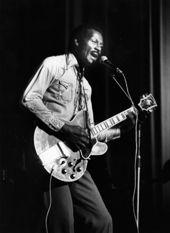 . 6th May 1977:  Hugely influential singer, songwriter and guitarist Chuck Berry, (Charles Edward Anderson), performing on stage with his guitar at the Birmingham Odeon in England.  (Photo by Keystone/Getty Images)