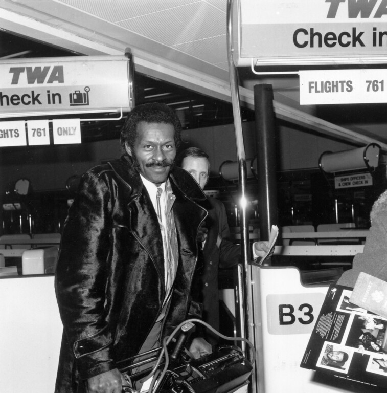 . 1st March 1975:  Legendary rock \'n\' roll singer, songwriter and  guitarist Chuck Berry checks in at the airport, March 1975.  (Photo by Evening Standard/Getty Images)