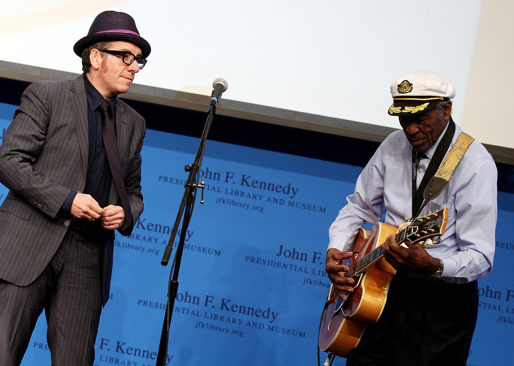. Boston, MA - FEBRUARY 26: Elvis Costello watches at honoree Chuck Berry performs during the 2012 Awards for Lyrics of Literary Excellence at The John F. Kennedy Presidential Library And Museum on February 26, 2012 in Boston, Massachusetts. (Photo by Marc Andrew Deley/Getty Images)