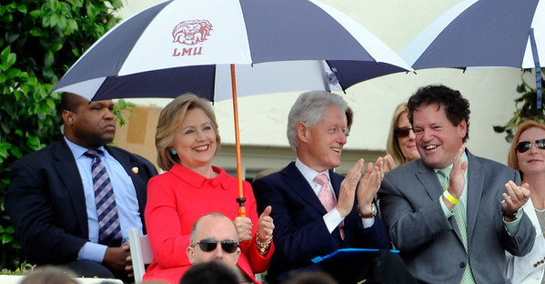 Democratic presidential candidate Hillary Clinton with her husband and former President Bill Clinton along with Roger Clinton Jr., right, who's son Tyler Clinton graduated during the Loyola Marymount 2016 Commencement on the campus of Loyola Marymount University on Saturday, May 7, 2016 in Los Angeles.   Authorities say Roger Clinton, younger half-brother of former President Clinton, has been arrested Sunday, June 5, 2016, on suspicion of drunken driving in the seaside city of Redondo Beach, Calif.  (Photo by Libby Cline)