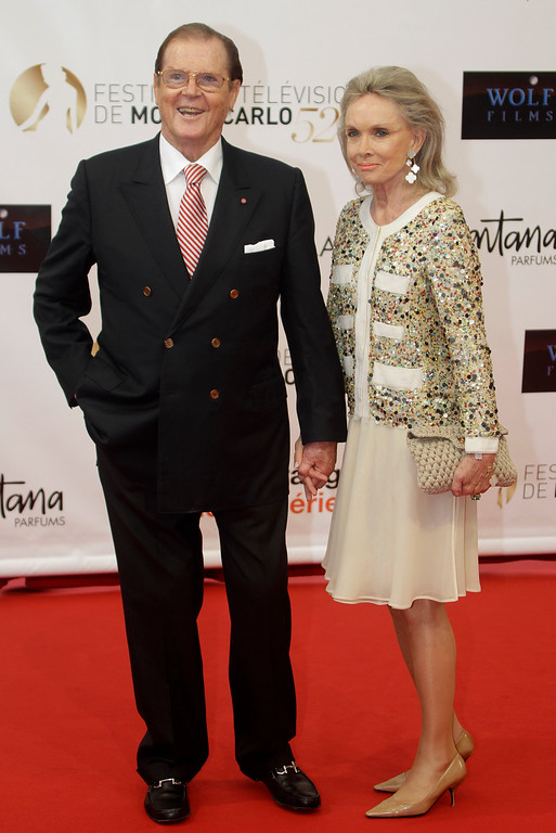 . British actor Roger Moore and his wife Kristina Tholstrup pose during the opening ceremony of the 2012 Monte Carlo Television Festival, Sunday, June 10, 2012, in Monaco. (AP Photo/Lionel Cironneau)