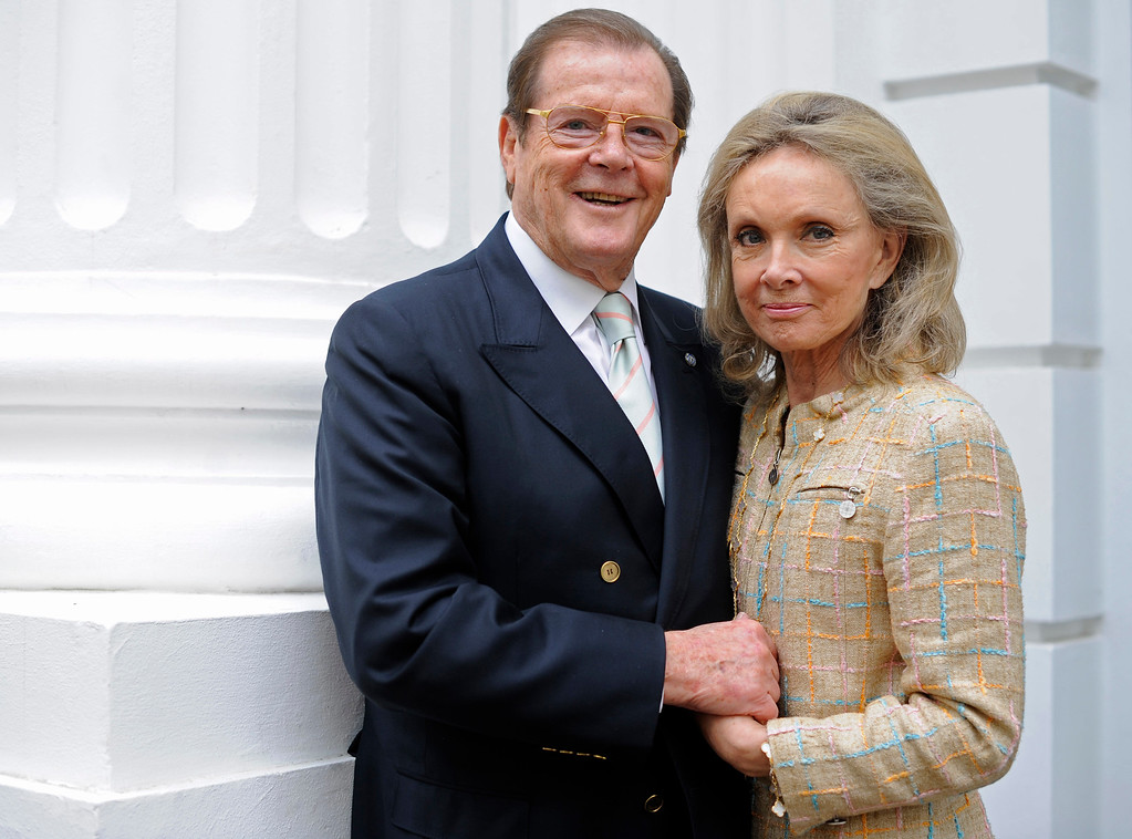 . British actor Roger Moore, left, and his wife Kristina Tholstrup pose for a photo during an interview with the Associated Press in Hamburg, northern Germany, on Wednesday, June 3, 2009. (AP Photo/Fabian Bimmer)