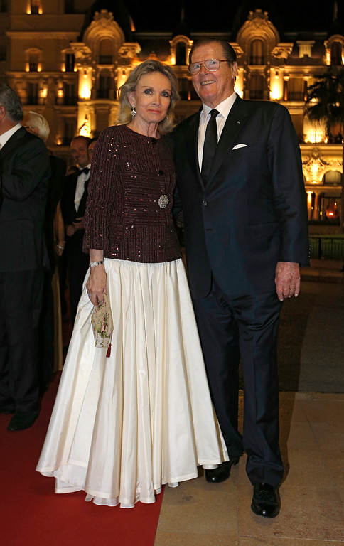 """. English actor Roger Moore and his wife Kristina Tholstrup pose during the  \""""South Africa Night Gala\"""", at the Monte Carlo opera,Saturday, Sept. 29, 2012, in Monaco. (AP Photo/Lionel Cironneau)"""