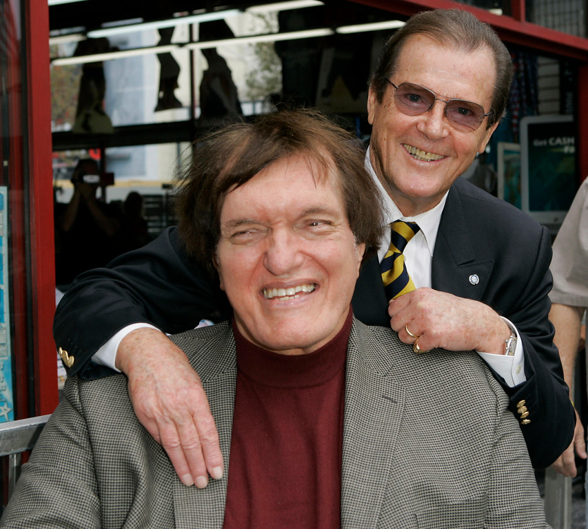 """. FILE - In this Oct. 11, 2007 file photo, actor Roger Moore, right, who played the part of James Bond 007 in seven films, poses with actor Richard Kiel who played the role of Jaws in \""""The Spy Who Loved Me,\""""  during a ceremony honoring Moore with a star on the Hollywood Walk of Fame, in the Hollywood section of Los Angeles.  Kiel, the 7-foot-2-inch performer famously played the cable-chomping henchman who tussled with Moore\'s Bond in \""""The Spy Who Loved Me\"""" and \""""Moonraker\"""" has died. He was 74. (AP Photo/Mark J. Terrill, file)"""