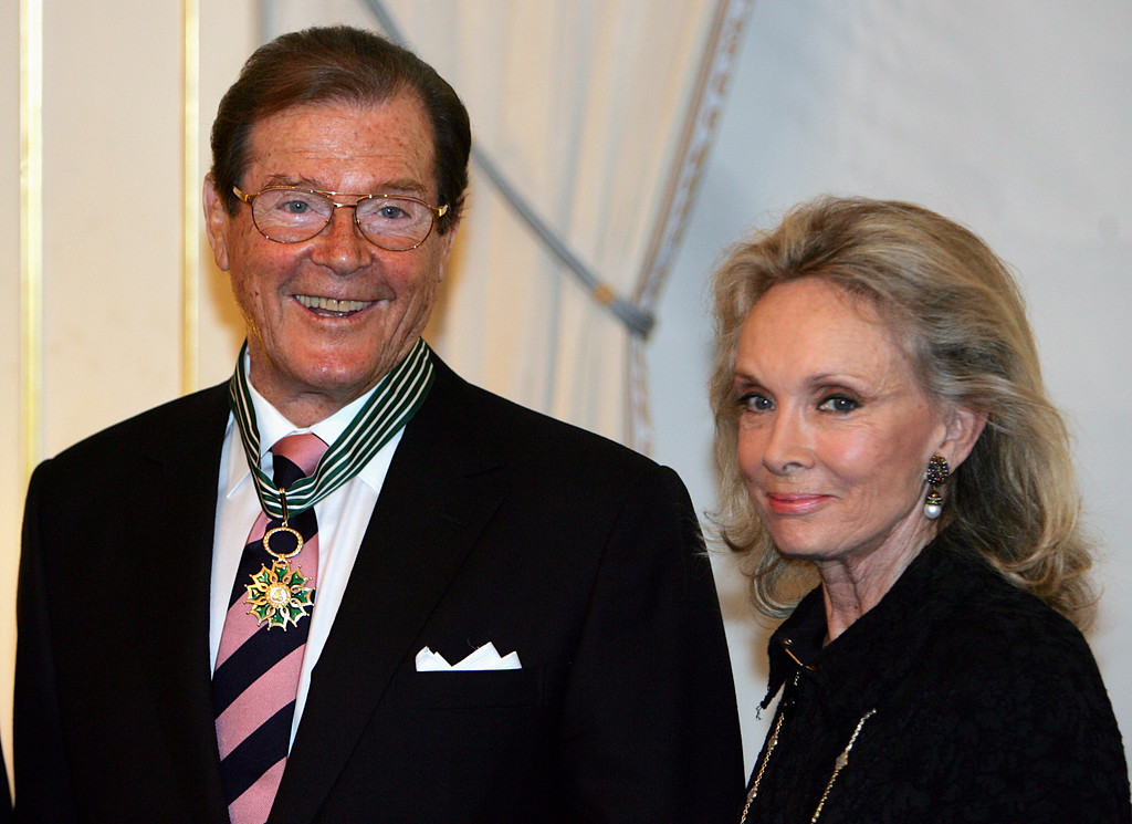 . British movie star Roger Moore and his wife Christina are seen during a ceremony where he was made Commander of Arts and Letters by French culture minister Christine Albanel, unseen,  at the French culture ministry in Paris Tuesday Oct. 28, 2008.(AP Photo/Remy de la Mauviniere)