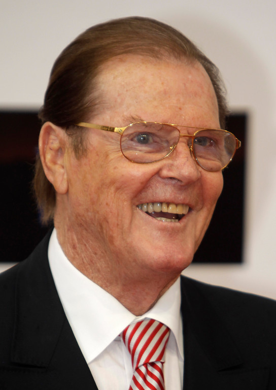 . British actor Roger Moore poses during the opening ceremony of the 2012 Monte Carlo Television Festival, Sunday, June 10, 2012, in Monaco. (AP Photo/Lionel Cironneau)