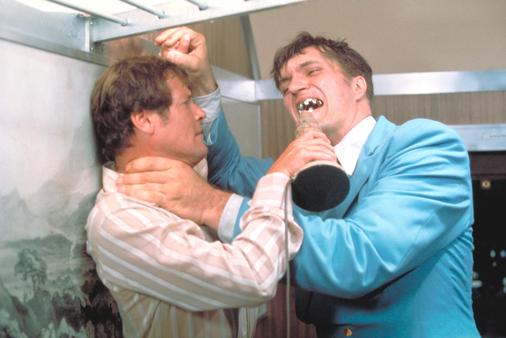 """. This undated publicity photo provided by United Artists and Danjaq, LLC shows Richard Kiel, right, as Jaws and Roger Moore, as James Bond, fighting in the 1977 film, \""""The Spy Who Loved Me.\"""" Those teeth could do some serious damage. The film is included in the MGM and 20th Century Fox Home Entertainment Blu-Ray \""""Bond 50\"""" anniversary set.  (AP Photo/United Artists and Danjaq, LLC)"""