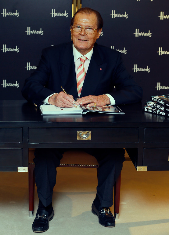 . British former James Bond actor Roger Moore poses for photographs at a book signing event for his new book \'Bond on Bond\' in London,  Thursday, Oct. 11, 2012. (AP Photo/Kirsty Wigglesworth)