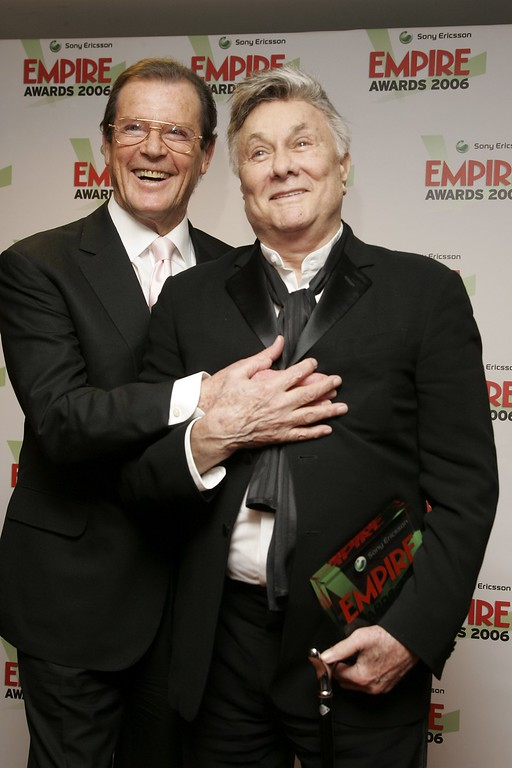 . Actors Roger Moore (L) and Tony Curtis pose in the awards room with the Empire Lifetime Achievement Award presented to Curtis by Moore at the Sony Ericsson Empire Film Awards 2006, the annual awards show voted for by the public, at the Hilton London Metropole on March 13, 2006 in London, England.  (Photo by Dave Hogan/Getty Images)
