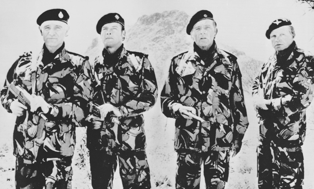 """. From left to right, actors Richard Harris, Roger Moore, Richard Burton and Hardy Kruger appear as officer-mercenaries in \""""The Wild Geese,\"""" Oct. 1977.  (AP Photo)"""