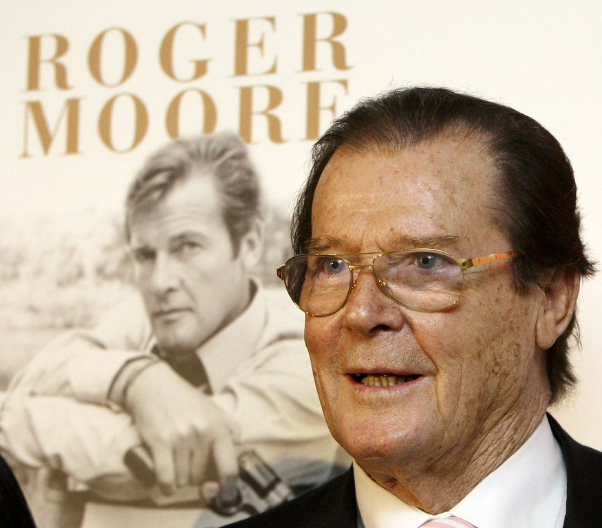 """. British actor Roger Moore attends the news conference to promote his latest book \""""The World is My Bond\"""" in Hong Kong Thursday, Nov. 27, 2008.  (AP Photo/Kin Cheung)"""