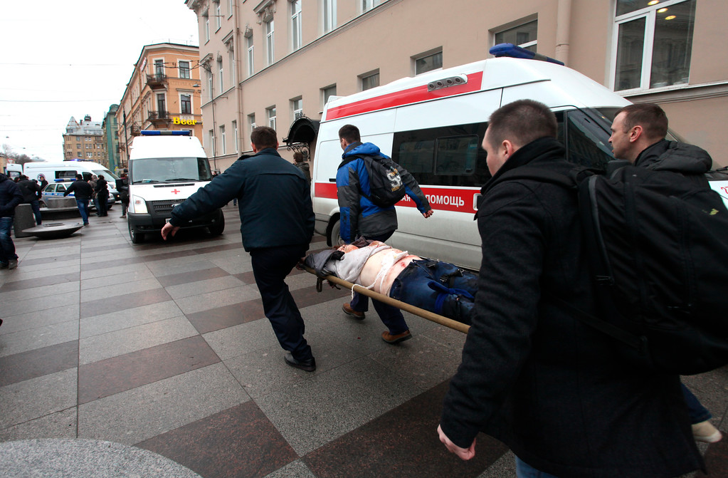 . People carrie a subway blast victim into an ambulance after explosion at Tekhnologichesky Institut subway station in St.Petersburg, Russia, Monday, April 3, 2017. The subway in the Russian city of St. Petersburg is reporting that there are fatalities and several people have been injured in an explosion on a subway train.  (Alexander Tarasenkov/Interpress via AP)