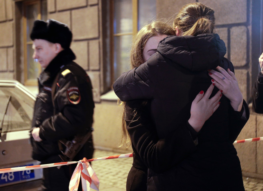 . Women cry near the Tekhnologichesky Institut subway station in St.Petersburg, Russia, Monday, April 3, 2017. A bomb blast tore through a subway train deep under Russia\'s second-largest city Monday, killing several people and wounding many more in a chaotic scene that left victims sprawled on a smoky platform. (AP Photo/Dmitri Lovetsky)