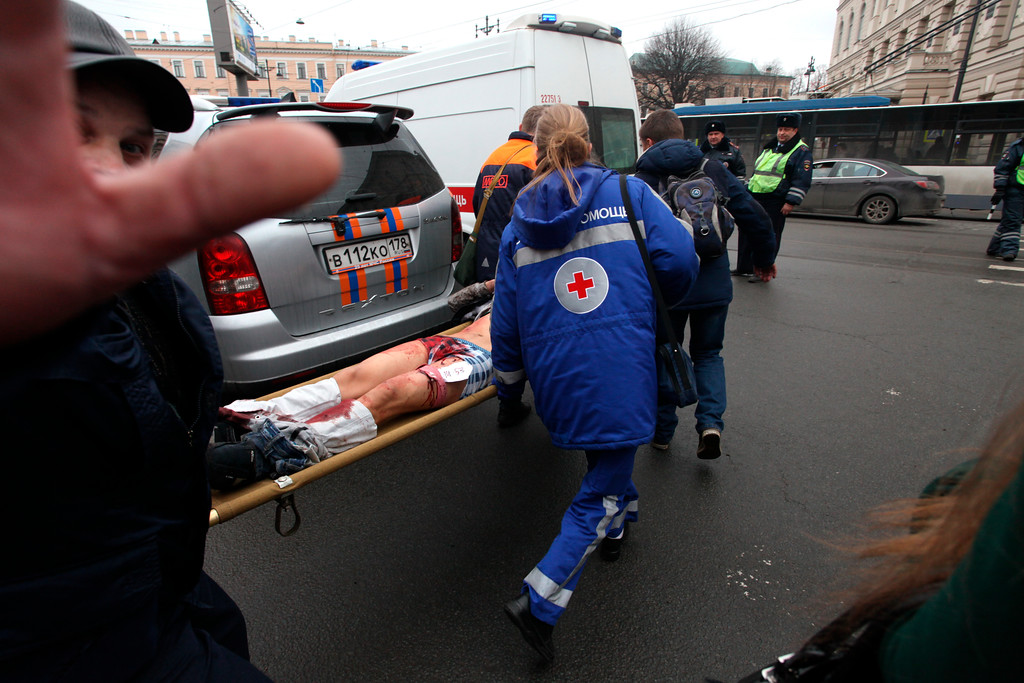 . Paramedics carrie a subway blast victim into an ambulance after explosion at Tekhnologichesky Institut subway station in St.Petersburg, Russia, Monday, April 3, 2017. The subway in the Russian city of St. Petersburg is reporting that there are fatalities and several people have been injured in an explosion on a subway train. (Alexander Tarasenkov/Interpress via AP)