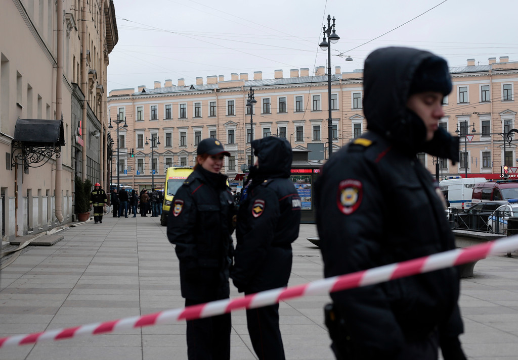 . Russian police officers stand guard in a street after a explosion in St. Petersburg\'s subway, Russia, Monday, April 3, 2017. The subway in the Russian city of St. Petersburg is reporting that there are fatalities and several people have been injured in an explosion on a subway train. (AP Photo/Evgenii Kurskov)