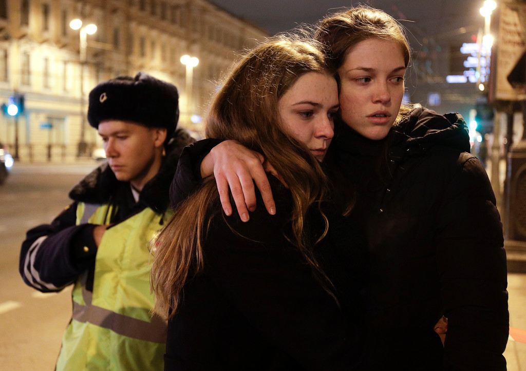 . Women grieve near the Tekhnologichesky Institut subway station in St.Petersburg, Russia, Monday, April 3, 2017. A bomb blast tore through a subway train deep under Russia\'s second-largest city Monday, killing several people and wounding many more in a chaotic scene that left victims sprawled on a smoky platform. (AP Photo/Dmitri Lovetsky)