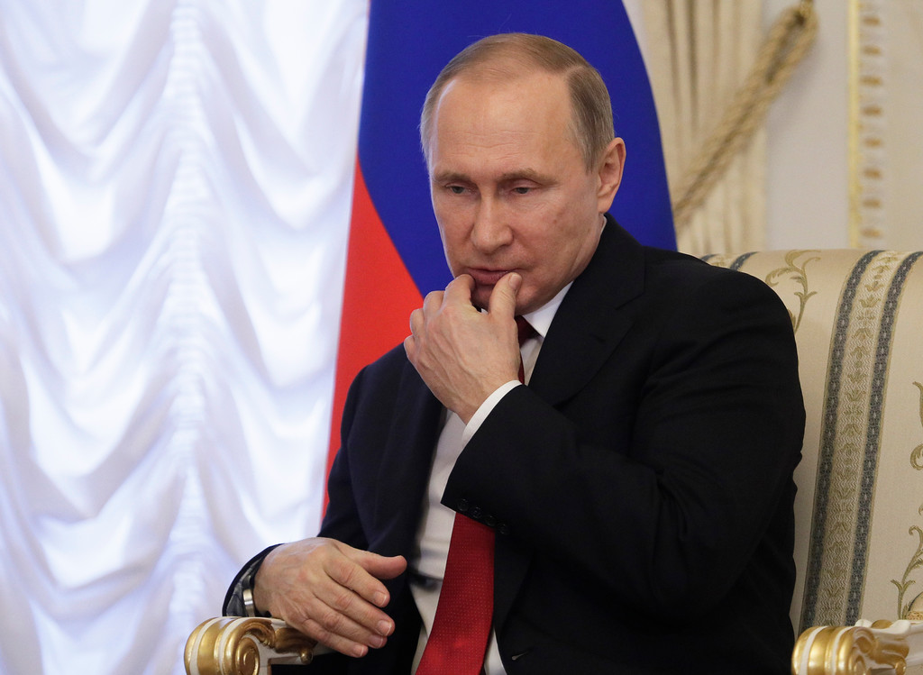 . Russian President Vladimir Putin gestures during his meeting with Belarus\' President Alexander Lukashenko at Konstantin palace in St.Petersburg, Russia, Monday, April 3, 2017.  Following an explosion on the subway in St. Petersburg, Putin, who was visiting the city on an unrelated trip Monday, said investigators are looking into whether the explosion was a terror attack. (AP Photo/Dmitri Lovetsky, pool)