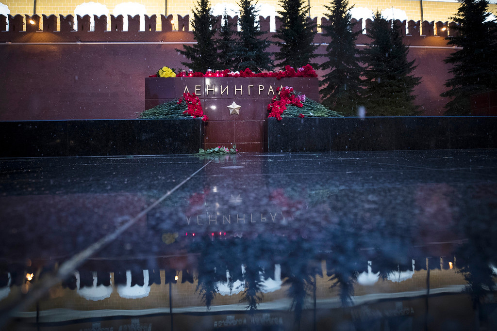 . Candles and flowers placed at the memorial stone with the word Leningrad (St. Petersburg) at the Tomb of Unknown Soldier in front of the Kremlin wall in Moscow, in memory of victims killed by a bomb blast in a subway train in St. Petersburg, Russia, Monday, April 3, 2017. A bomb blast tore through a subway train in Russia\'s second-largest city Monday, killing several people and injuring many more as President Vladimir Putin visited the city, authorities said. (AP Photo/Pavel Golovkin)