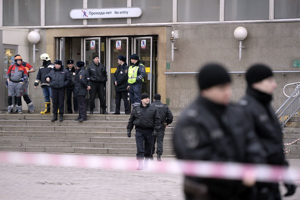 ". Police officers guard the entrance to Sennaya Square metro station in Saint Petersburg on April 3, 2017. Russia\'s Investigative Committee said Monday it was probing a suspected ""act of terror\"" after a blast in the Saint Petersburg metro killed about 10 people and injured dozens.  (OLGA MALTSEVA/AFP/Getty Images)"