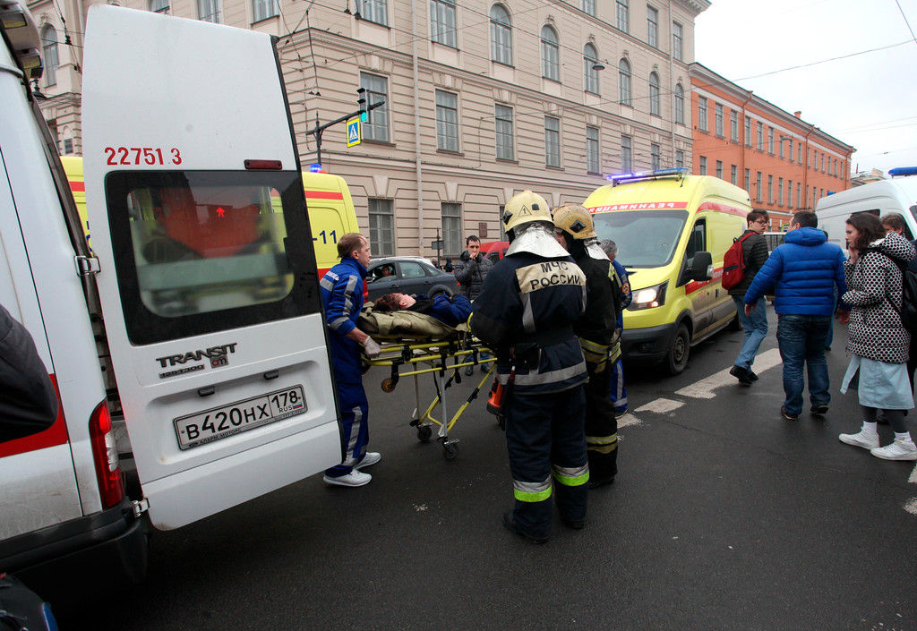 . People carry a subway blast victim into an ambulance after explosion at Tekhnologichesky Institut subway station in St.Petersburg, Russia, Monday, April 3, 2017.  The subway in the Russian city of St. Petersburg is reporting that there are fatalities and several people have been injured in an explosion on a subway train. (Alexander Tarasenkov/Interpress via AP)