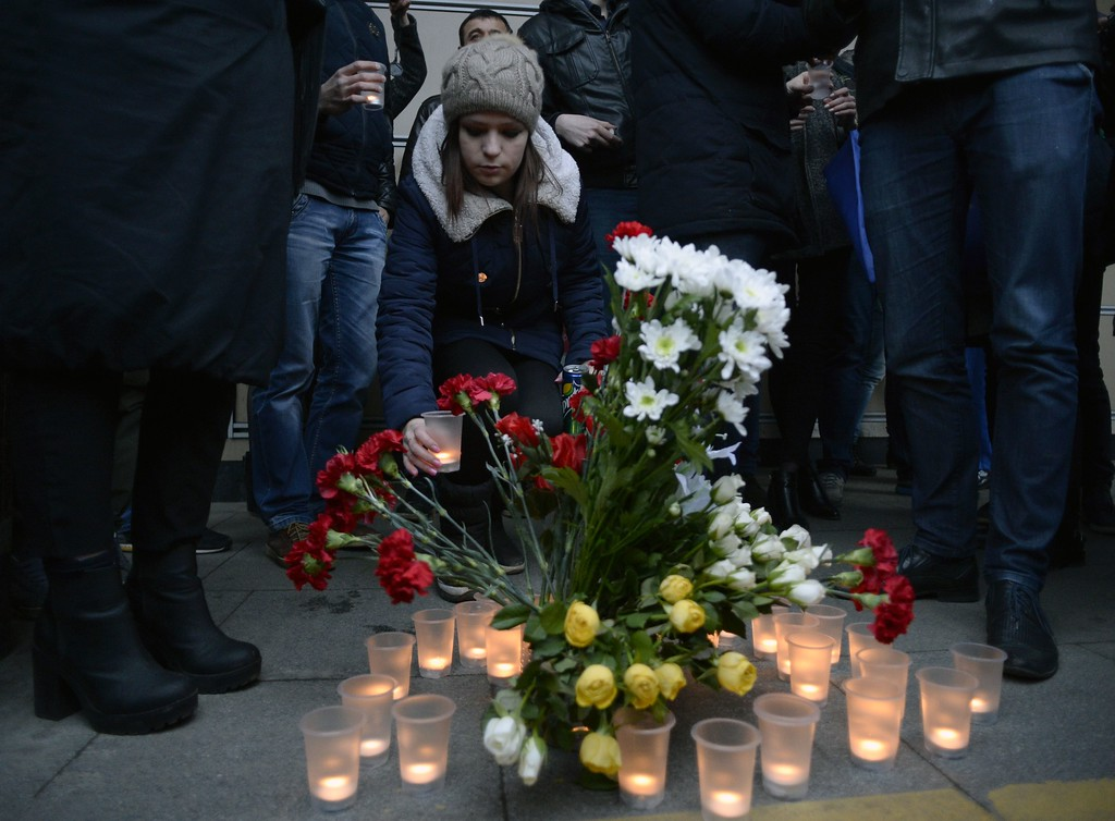 ". People place flowers and lit candles in memory of victims of the blast in the Saint Petersburg metro outside Sennaya Square station on April 3, 2017. Ten people were killed and several more injured Monday after an explosion rocked the metro system in Russia\'s second city Saint Petersburg, and authorities launched a probe into suspected ""act of terror\"". (OLGA MALTSEVA/AFP/Getty Images)"