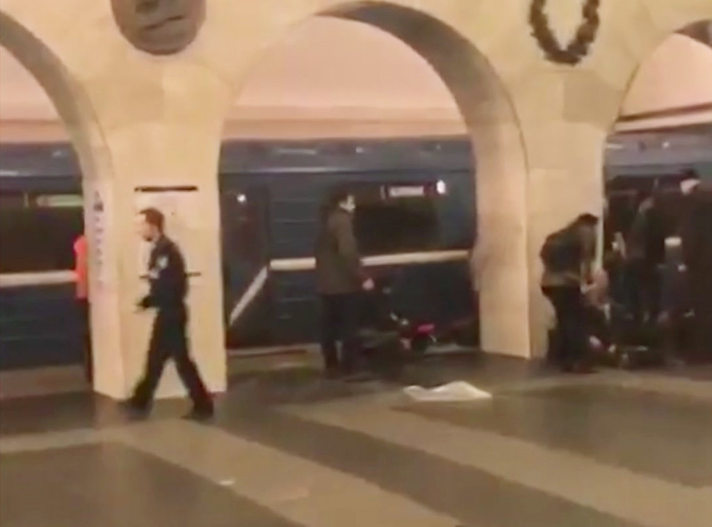 . In this image taken from video footage filmed from a moving train on the opposite platform to where the blast occurred, people injured in blast. right, at St. Petersburg\'s Technological Institute metro station lay on ground, Russia, Monday, April 3, 2017. At least 10 people were killed Monday in an explosion on the subway in St. Petersburg, Russian news agencies reported. (@DARIIIIIINA via AP)