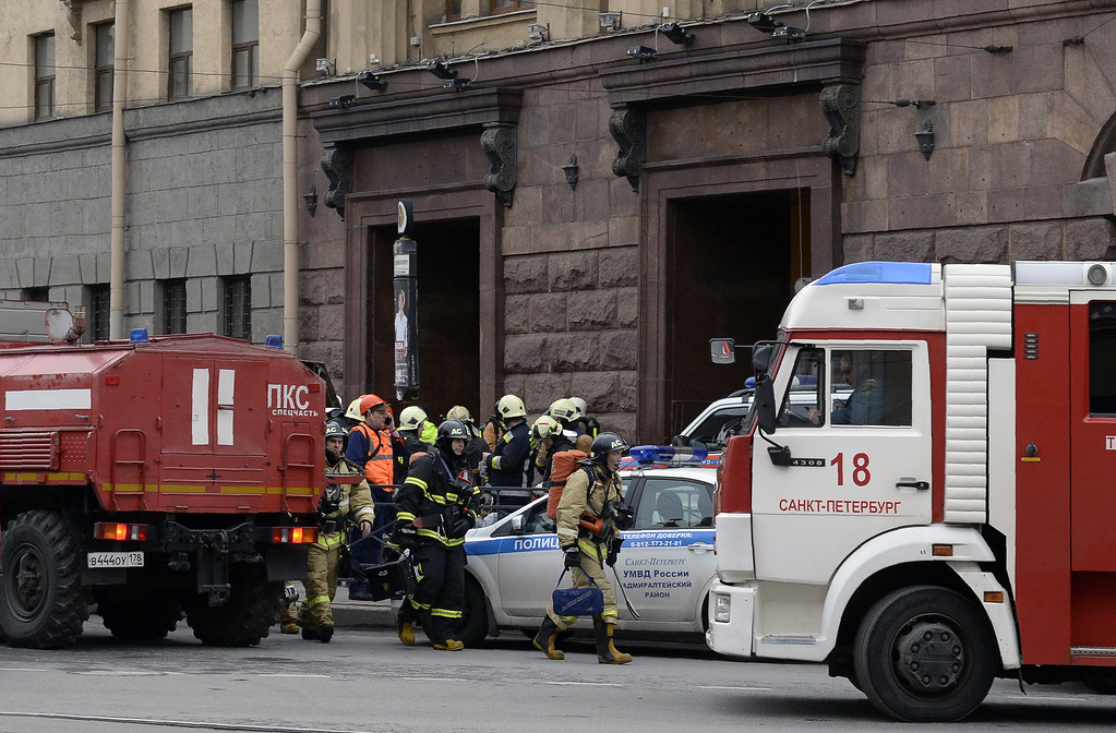 . TOPSHOT - Emergency services personnel walk at the entrance to Technological Institute metro station in Saint Petersburg on April 3, 2017. Around 10 people were feared dead and dozens injured Monday after an explosion rocked the metro system in Russia\'s second city Saint Petersburg, according to authorities, who were not ruling out a terror attack. (OLGA MALTSEVA/AFP/Getty Images)