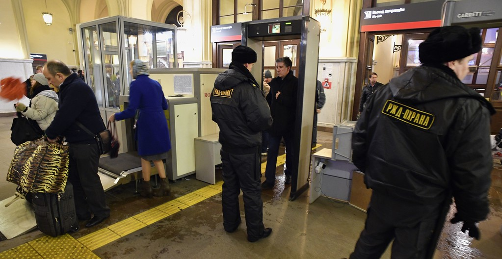 ". Security personnel check passengers at the entrance to Leningradsky railway station in Moscow on April 3, 2017. Russia opened a probe into a suspected ""act of terror\"" Monday after 10 people were killed and dozens more injured in a blast that rocked the Saint Petersburg metro. (ALEXANDER NEMENOV/AFP/Getty Images)"