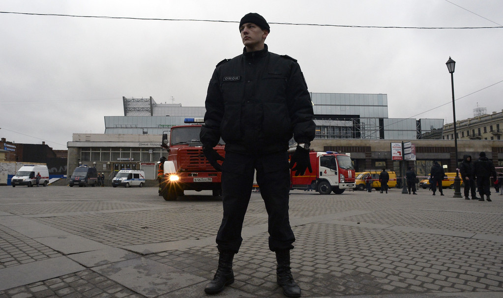 ". A riot police officer guards the area next to the entrance to Sennaya Square metro station in Saint Petersburg on April 3, 2017. Russia\'s Investigative Committee said Monday it was probing a suspected ""act of terror\"" after a blast in the Saint Petersburg metro killed about 10 people and injured dozens.  (OLGA MALTSEVA/AFP/Getty Images)"