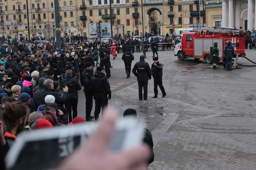 . Russian police and emergency service officers block an area next to fire trucks at Sadovaya Square after explosion in St.Petersburg subway in St. Petersburg, Russia, Monday, April 3, 2017. The subway in the Russian city of St. Petersburg an explosion on a subway train. (AP Photo/Yevgeny Kurskov)