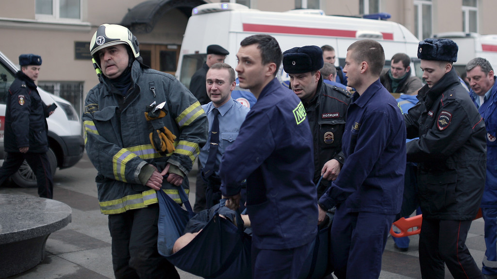 . Police and emergency services personnel carry an injured person on a stretcher outside Technological Institute metro station in Saint Petersburg on April 3, 2017. Around 10 people were feared dead and dozens injured Monday after an explosion rocked the metro system in Russia\'s second city Saint Petersburg, according to authorities, who were not ruling out a terror attack. (ALEXANDER BULEKOV/AFP/Getty Images)