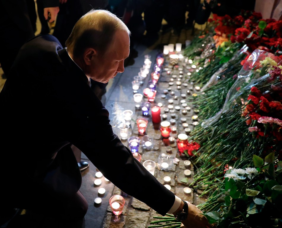 . Russian President Vladimir Putin lays flowers at a place near the Tekhnologichesky Institut subway station in St.Petersburg, Russia, Monday, April 3, 2017. A bomb blast tore through a subway train deep under Russia\'s second-largest city Monday, killing several people and wounding many more in a chaotic scene that left victims sprawled on a smoky platform. (Mikhail Klimentyev/Pool Photo via AP)