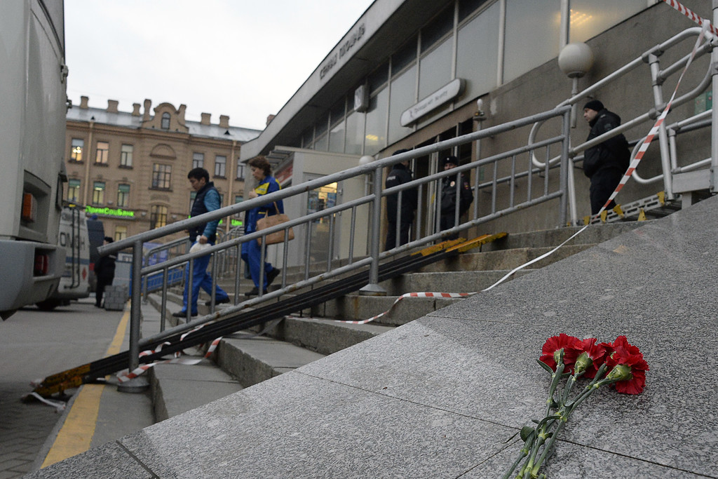 ". Flowers in memory of victims of the blast in the Saint Petersburg metro are seen outside Sennaya Square station on April 3, 2017. Ten people were killed and several more injured Monday after an explosion rocked the metro system in Russia\'s second city Saint Petersburg, and authorities launched a probe into suspected ""act of terror\"". (OLGA MALTSEVA/AFP/Getty Images)"