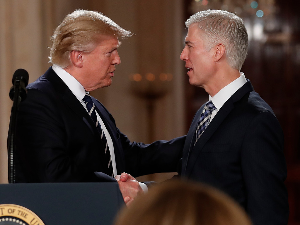 . President Donald Trump shakes hands with 10th U.S. Circuit Court of Appeals Judge Neil Gorsuch, his choice for Supreme Court Justices in the East Room of the White House in Washington, Tuesday, Jan. 31, 2017. (AP Photo/Carolyn Kaster)