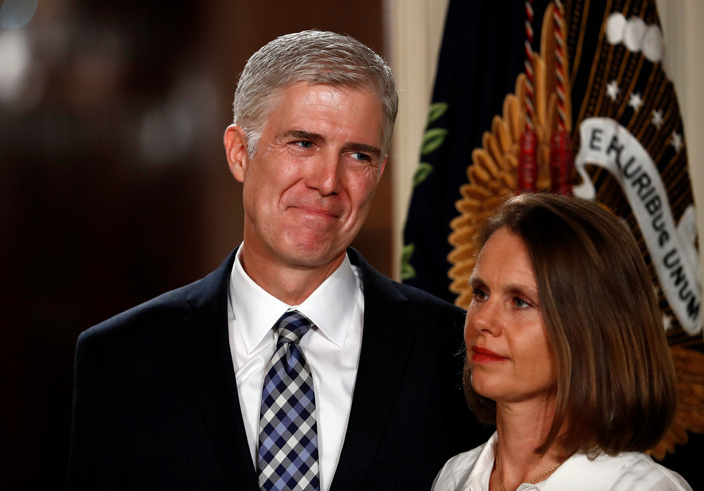 . Judge Neil Gorsuch stands with his wife Louise as President Donald Trump speaks in the East Room of the White House in Washington, Tuesday, Jan. 31, 2017, to announce Gorsuch as his nominee for the Supreme Court.(AP Photo/Carolyn Kaster)