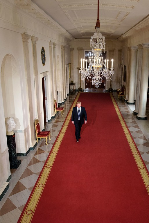 . US President Donald Trump walks through the Cross Hall to the East Room to nominate Neil M. Gorsuch to take Justice Antonin Scalia\'s vacancy on the US Supreme Court during an event at the White House January 31, 2017 in Washington, DC. President Donald Trump nominated federal appellate judge Neil Gorsuch as his Supreme Court nominee, tilting the balance of the court back in the conservatives\' favor. (BRENDAN SMIALOWSKI/AFP/Getty Images)