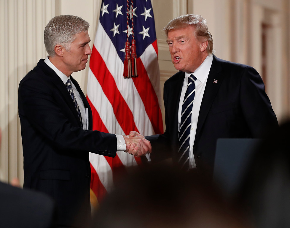 . Judge Neil Gorsuch shakes hands with President Donald Trump as he is  announced as Trump\'s choice for Supreme Court Justice during a televised address from the East Room of the White House in Washington, Tuesday, Jan. 31, 2017 (AP Photo/Carolyn Kaster)